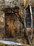 Closed wooden door in old building. Old worn weather beaten building doorway, at an old abandoned lumber mill, leverett, massachusetts Stock Photography