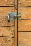 Closed wooden door with padlock and bolt Stock Images