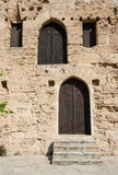 Closed wooden doors of medieval fortress Stock Images