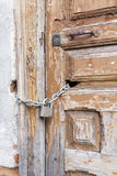 Closed wooden exterior door of an ancient house. Old closed wooden exterior door of an ancient house Royalty Free Stock Photo