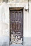 Closed wooden exterior door of an ancient house. Old closed wooden exterior door of an ancient house Stock Images