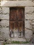 Closed wooden exterior door of an ancient house. Old closed wooden exterior door of an ancient house Royalty Free Stock Photos