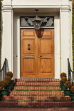 Closed wooden front door of an upscale home Royalty Free Stock Photos