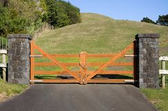 Closed Wooden Gate. A closed wooden gate on a vacant paddock in the New Zealand countryside Stock Photos