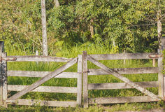 Closed wooden gate in countryside Royalty Free Stock Images