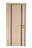 Closed wooden oak door in doorway isolated. Closed wooden door in doorway isolated on white Royalty Free Stock Image