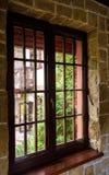 Closed wooden plastic vinyl window in old interior Stock Images
