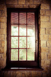 Closed wooden plastic vinyl window in old interior Stock Image