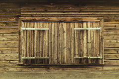 Closed wooden shutters on mountain cabin Stock Image