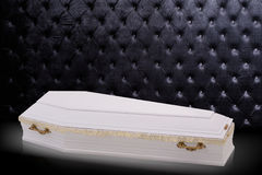 Closed wooden white coffin isolated on gray luxury background. casket, coffin on royal background. Stock Photography