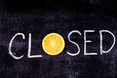 Closed written in chalk on a blackboard. To store citrus Stock Images