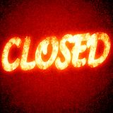 Closed. Written on a glowing red background Royalty Free Stock Photography