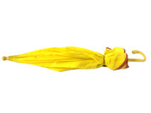 Closed yellow umbrella. Isolated on white background Royalty Free Stock Photos