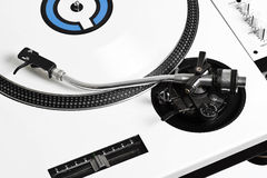 Closedup dj turntable with white vinyl. Closedup of white turntable with white vinyl stock image