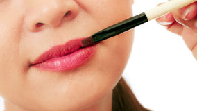 Closedup on the lips of an asian middle age woman Stock Image