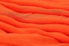 Closedup of orange textile fabrics Stock Photos