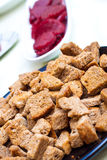 Closee up of croutons with beet in the backgroung Royalty Free Stock Images