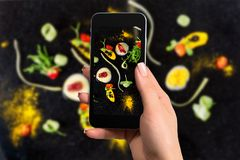 Closely image of female hands holding mobile phone with photo camera mode on the screen abstract gastronomy vanguard royalty free stock photography