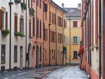 Tight european street in rainy day royalty free stock photo