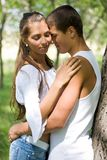 Closeness. Photo of pretty girl and her boyfriend embracing outdoors Royalty Free Stock Photography