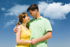 Closeness. Photo of amorous couple smiling at each other on background of bright sky Stock Photography