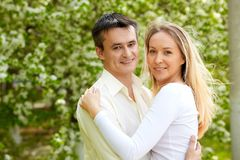 Closeness. Portrait of young couple looking at camera in park Stock Photography