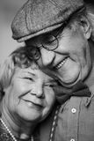 Closeness. Black-and-white image of senior couple in smart clothes royalty free stock photo