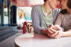 Closeness. Close-up of romantic couple sitting in cafe on summer day Stock Images