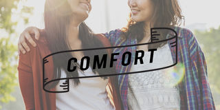 Closeness Comfort Happiness Relationship Love Concept. Sisters holding each other with comfort word Royalty Free Stock Photo