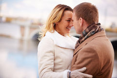 Closeness. Portrait of amorous men and women standing face to face outside Stock Photo