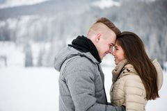 Closeness of romantic smiling teenage couple. Cheerful teen couple in love touching foreheads Stock Photography
