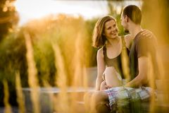Closeness of romantic smiling young couple. Young cheerful couple gazing at each other stock photos
