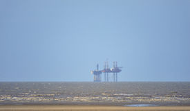 Closer and closer to Shore!. An image of an exploratory gas rig, very close to the shoreline of the UK north west coast in the Irish sea. This geographical area stock photography