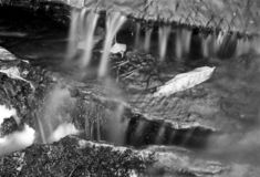 Small waterfall with leaf - shot with analogue film. A closer detail image of a small waterfall. Location: Uddevalla, Sweden. Image is taken with a full-frame stock images