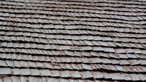 Closer image of the wooden shingle shake roof prickles stock video footage