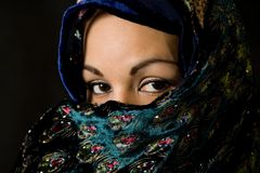 A closer look. Women close look and cover with vail stock photo