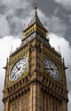 Closer look of Big ben. In pale cloudy sky, London, England Stock Images