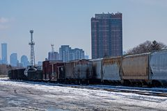 Closer Look At Freight Cars Sit Idle At The Toronto Shipping Yards. Looking east toward downtown Toronto, Ontario, Canada on the Canadian Pacific freight lines royalty free stock image