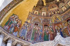 Close up of a section of mosaic on St. Mark`s Basilica in Venice. A closer look of the mosaic on St. Mark`s Basilica: `Translation of the body of St. Mark to the Royalty Free Stock Photo