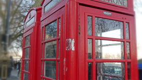 Closer look of the red telephone booth in London stock footage