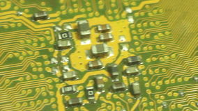 Closer Macro Camera Dolly across computer circuit board. Fast dolly doagonally along etched and printed circuits, stock video