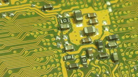 Closer Macro ECU Camera Dolly across computer circuit board. Start from the edge of the circuit board,then pause on central circu stock video footage