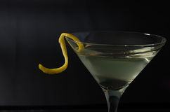Closer martini. Closer view of a vodka or gin martini with a lemon twist stock photography