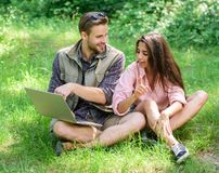 Closer to nature. Modern technologies give opportunity to be online and work in any environment conditions. Man and girl. Looking at laptop screen. Couple youth stock photography