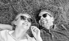 Closer to nature. Nature fills them with freshness and inspiration. Man unshaven and girl lay on grass meadow. Guy and. Girl happy carefree enjoy freshness of royalty free stock images