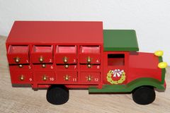 Closer and top view on a colorful wooden truck as an advent calendar in niederlangen. Emsland germany photographed indoors at my home on a wooden ground and royalty free stock image