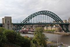 Closer view at the bridge over the river tyne under a cloudy sky in newcastle north east england united kingdom royalty free stock image