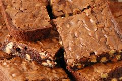 Closer view of fresh baked brownies. Freshly baked peanut butter chip brownies royalty free stock photos