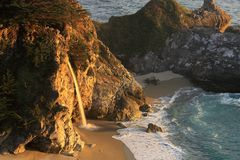 McWay Falls in Julia Pfeiffer-Burns State Park, Big Sur, California. Closer view of McWay Falls, the only coastal waterfall in Big Sur, in evening light Royalty Free Stock Photography