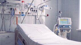 Closer view of a part of a hospital ward where the bed and other equipment are located. 4K stock video footage